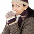 Attractive lady sheltered for winter drinking tecup — Stock fotografie #9507845