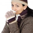 Attractive lady sheltered for winter drinking tecup — Stock Photo #9507845