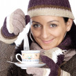 Attractive lady sheltered for the winter drinking a tea cup — Stock Photo #9507862