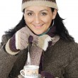 Attractive lady sheltered for winter drinking tecup — Stok Fotoğraf #9507865