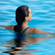 Woman in a swimming pool - Foto Stock