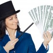 Attractive business woman with a magic wand and hat making appea - Stock fotografie