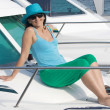 Beautiful woman aboard a yacht sunbathing — Stock Photo #9508029