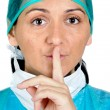 Lady doctor gesture asks silence — Stock Photo