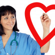 Medical cardiologist drawing a heart — Stock Photo #9508114