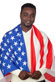 Attractive african man with a American flag — Photo