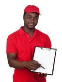 Kırmızı üniformalı işçi kurye — Stok fotoğraf