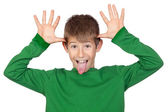 Funny child with green t-shirt mocking — Stock Photo