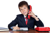 Little businessman talking on the phone — Stock fotografie