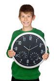 Adorable boy with a big clock — Stock Photo