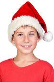 Noel baba şapkası ile şirin çocuk — Stok fotoğraf