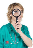 Doctor with magnifying glass — Stock Photo