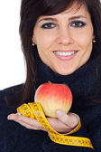 Woman whit apple and measuring tape — Stock Photo