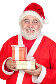 Smiley Santa Claus with two gifts — Stock Photo