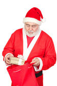 Santa Claus getting a gift from his sack — Stock Photo
