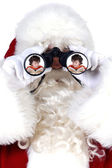 Santa claus s dalekohledem — Stock fotografie
