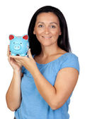 Adorable woman with a blue money-box — Foto de Stock