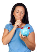 Pensive woman with a blue money-box — Stock Photo