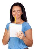 Brunette woman lookin a notebook — Stock Photo