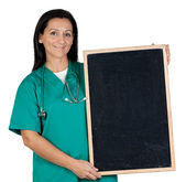 Attractive doctor with a blank slate — Stock Photo