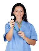 Attractive brunette doctor with a stethoscope — Stock Photo