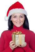 Beautiful girl with a Christmas present — Stock Photo