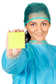 Happy doctor with post-in in the hand — Stock Photo