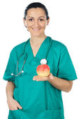 Lady doctor and apple — Stock Photo