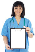 Lady doctor whit clipboard — Stock Photo