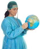 Doctor examining the planet earth — Stock Photo