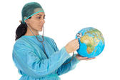Attractive lady doctor curing the ill world — Stock Photo