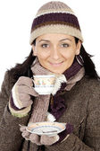 Attractive lady sheltered for the winter drinking a tea cup — Stok fotoğraf