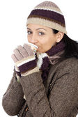 Attractive lady sheltered for the winter drinking a tea cup — Стоковое фото