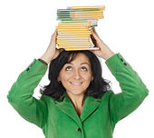 Attractive lady with a books in the head — Stock Photo
