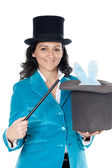 Attractive business woman with a magic wand and hat — Stock Photo