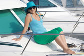 Beautiful woman aboard a yacht sunbathing — Stock Photo
