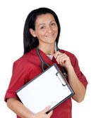 Happy doctor woman with clipboard in blank thinking — Stock Photo