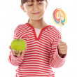 Girl with lollipop and apple — Stok fotoğraf