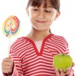 Girl with lollipop and apple — Stock Photo