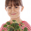 Adorable girl with a plant — Stock Photo