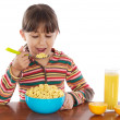 Girl eating breakfast — Stock Photo #9624992