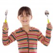 Adorable girl with fork and spoon ready to lunch — Stock Photo #9625008