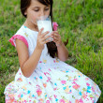 Girl drinking milk — Stock Photo #9625070