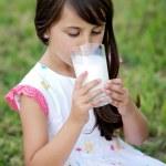 Girl drinking milk — Stock Photo #9625073