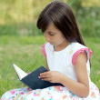 Girl with a book — Stock Photo #9625076