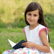 Girl with a book — Stok fotoğraf