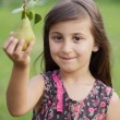 Girl taking a pear — Stock Photo #9625089