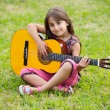Girl with a guitar — Stock Photo #9625091