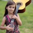 Girl with a guitar — Stock Photo #9625100