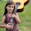 Girl with a guitar - Stockfoto
